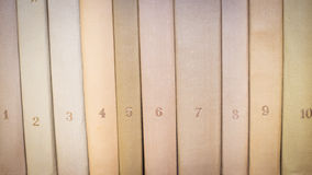 Books with numbers. Old books on a wooden shelf Royalty Free Stock Images