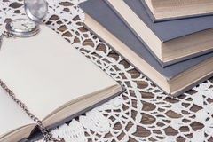 Books and old clock Royalty Free Stock Images