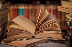 Books. Old books on the library reading table Stock Image