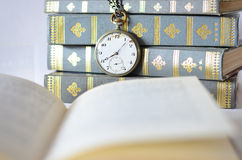 Books with old watch Royalty Free Stock Photography