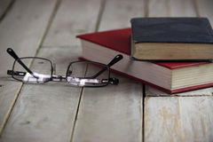 Books on an old wooden surface Royalty Free Stock Photo