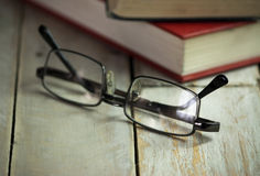 Books on an old wooden surface Stock Photography