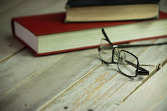 Books on an old wooden surface Royalty Free Stock Images