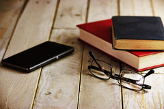 Books on an old wooden surface Royalty Free Stock Image