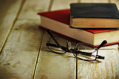 Books on an old wooden surface Stock Image