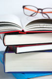 Books with open book Stock Images