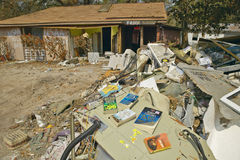 Books out to dry and debris in front of house heavily hit by Hurricane Ivan in Pensacola Florida Royalty Free Stock Photography