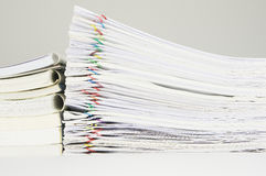 Books with paper of report and paperwork. On table near wall Royalty Free Stock Image