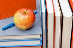 Books, pen and apple Royalty Free Stock Images