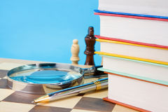 Books, pen and chess Royalty Free Stock Image