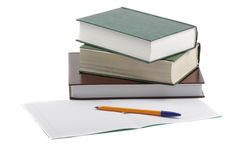 Books pen and copybook. Three books, yellow pen and copybook laying on light background Stock Photo