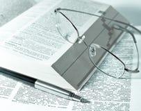 Books, pen and glasses Stock Photo