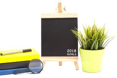 Books,pen,magnifying glass and Chalkboard. Books,pen,magnifying glass,green plant and chalkboard isolate over white background with copy space royalty free stock image
