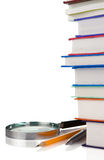Books, pen, pencil and magnifying glass Stock Photography