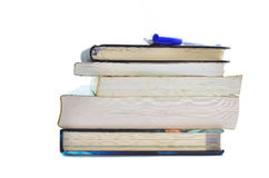 Books with pen on white background Royalty Free Stock Photography