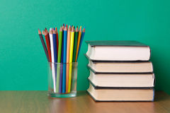 Books and pencils on the desk Royalty Free Stock Photo
