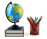 Books, pencils and globe Stock Photos