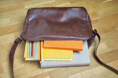 Books and pencils in the leather backpack Royalty Free Stock Photos