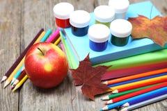 Books, pencils and maple leaf Stock Photo