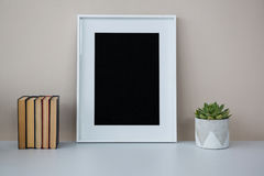 Books, picture frame and pot plant. In office royalty free stock photography
