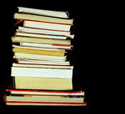 Books pile. Isolated on black with empty, editable space stock photo