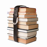 Books pile with belt. Many books pile with black leather belt Royalty Free Stock Images