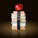 Books pile with belt Stock Photos