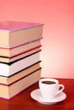 Books pile and cup of coffee Stock Images