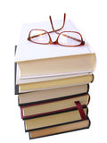 Books pile with glasses on top Royalty Free Stock Image