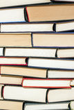 Books pile. Large stack of hardcover books in various colors Stock Photos