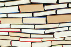 Books pile. Large stack of hardcover books in various colors Stock Images