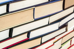 Books pile. Large stack of hardcover books in various colors Royalty Free Stock Images