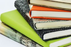 Books. A pile of books in several colours Stock Photos