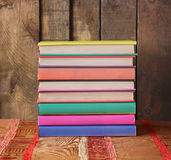 Books. Pile of books on a table with a red cloth against from boards. Back to school Royalty Free Stock Photography