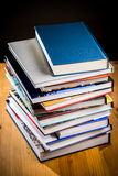 Books. A pile of books on a wooden desk Royalty Free Stock Image