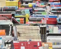 Books at Bookseller stand. Books piled on a street bookseller during a street books fair on the books day in the island of Mallorca, Spain royalty free stock image