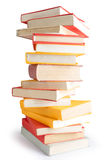 Books piled up. Big stack of books isolated on white background stock photography