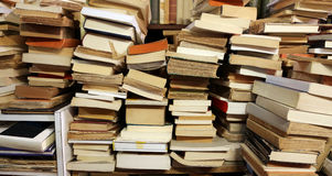 Books piled up for sale in the great library Royalty Free Stock Images