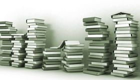 Books piles and wall Stock Images
