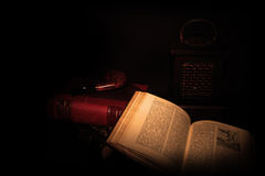 Books pipe and night lamp. In the darck Royalty Free Stock Photography