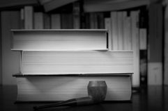 Books and pipe. Three books and a smoking pipe Royalty Free Stock Images