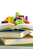 Books and plastic letters stock image