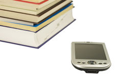 Books and the pocket computer Royalty Free Stock Images