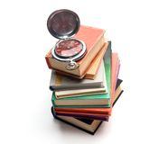 Books and pocket watch. Pocket watch on a pile of books Royalty Free Stock Photo