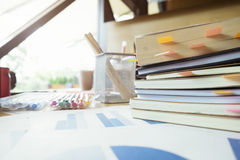 Books with post-it bookmarks on working table. Royalty Free Stock Image
