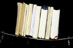 Books putting in a raw. royalty free stock photo
