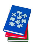 Books with puzzles isolated. Stock Photos