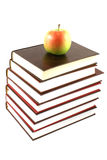 Books pyramid with apple royalty free stock image
