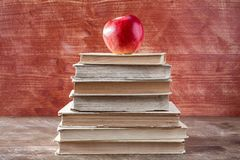 Books pyramid with red apple royalty free stock photography