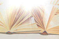 Books in the rays of light. Open books in the rays of golden light Stock Photography